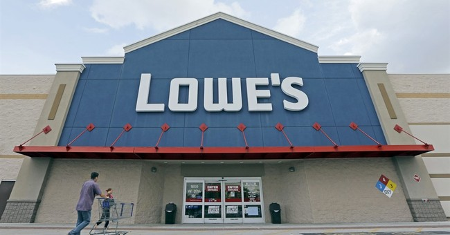 Lowe's cashes in on housing rally, just not as much as rival