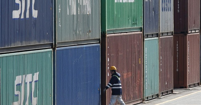 Japan's trade shrinks in July, exports sink 14 percent
