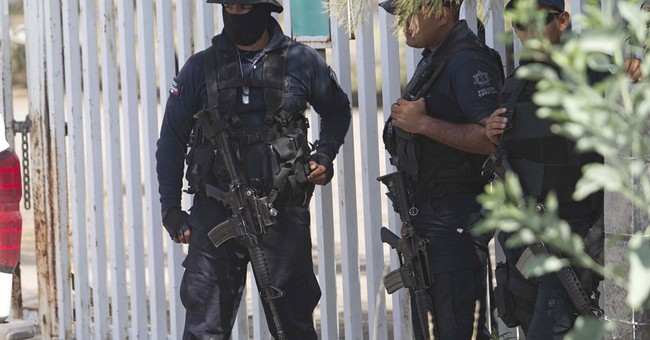 Mexico's rights body: Federal police executed 22 during raid