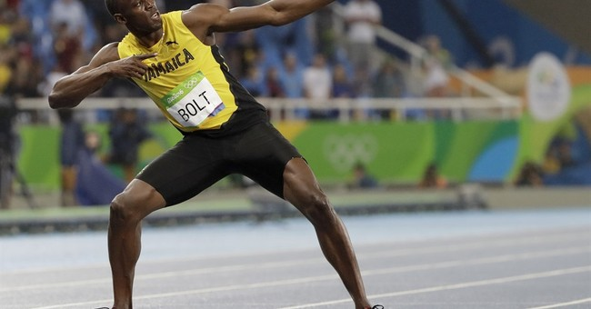 High standards: Bolt wins gold again, but misses record
