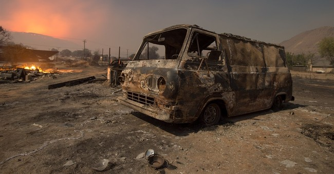 Evacuated residents in limbo as wildfire burns in California