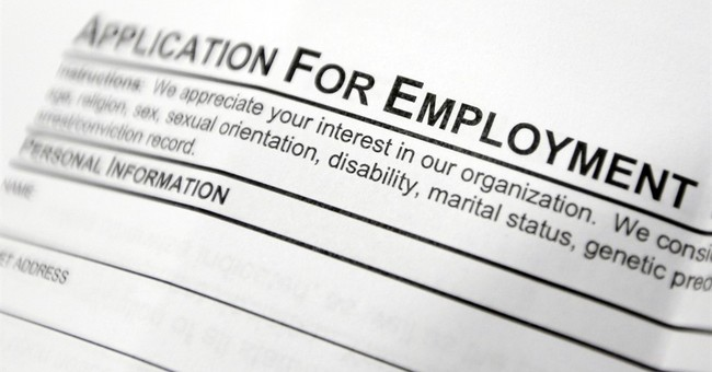 Applications for US unemployment benefits fall to 262,000