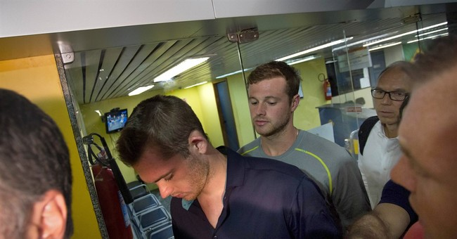 2 Lochte teammates in robbery probe pulled off plane