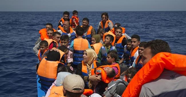 AP witnesses rescue of migrants off Libya, 4 bodies found