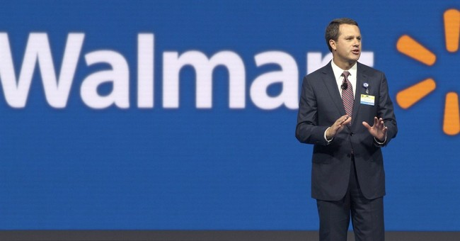 Wal-Mart raises annual profit outlook, reports strong sales