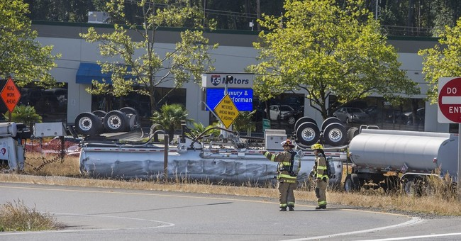 Washington freeway reopens after tank truck rollover