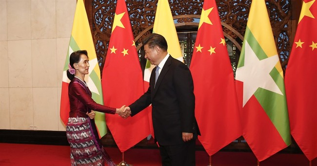 Suu Kyi meets Chinese president during visit to boost ties