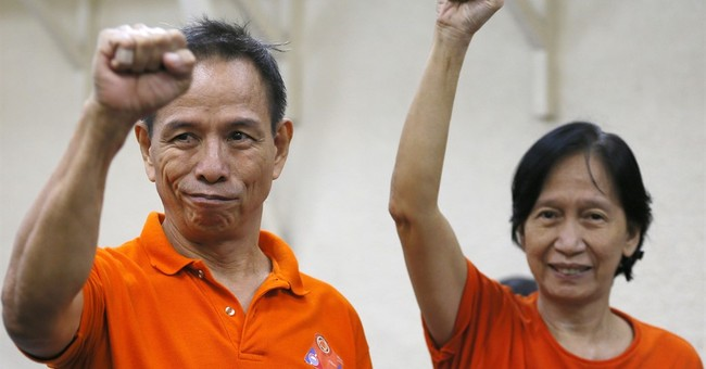 Philippines frees top communist leaders to join peace talks