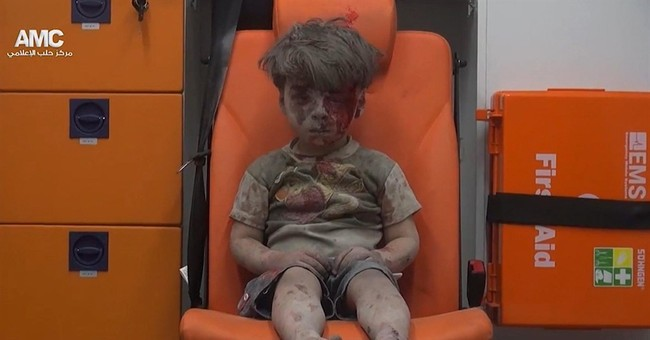 Brother of Syrian boy wounded in Aleppo dies