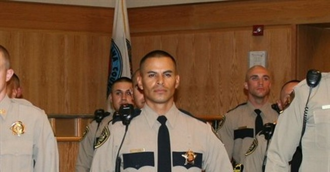 The Latest: Public honors slain New Mexico police officer