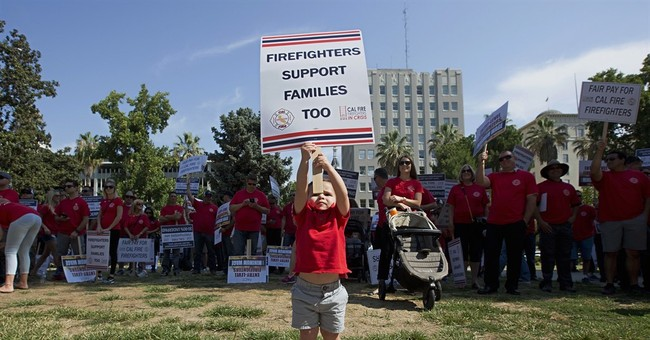 California firefighters stretched thin as blazes sweep state