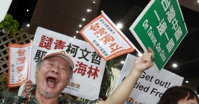 Chinese envoy visits Taiwan amid protests