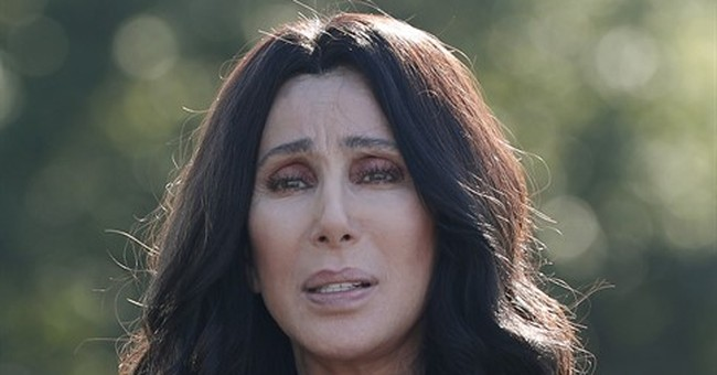 Cher insults Trump, with gusto, at Clinton fundraiser