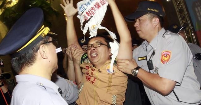 Chinese envoy visits Taiwan amid protests