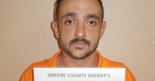 The Latest: Sheriff: Man used ax, then gunshots in massacre