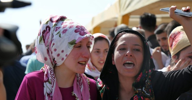 The Latest: Turkey not sure if wedding party bomber a child