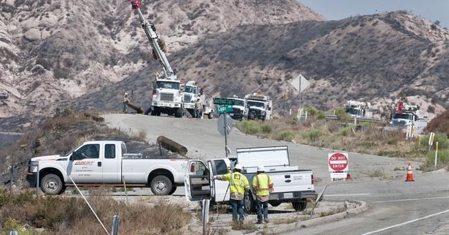 The Latest: Fire near Utah ski resort crosses Idaho border