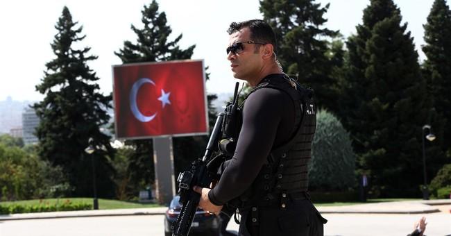 The Latest: Report: Turkey evacuates town near Syria border