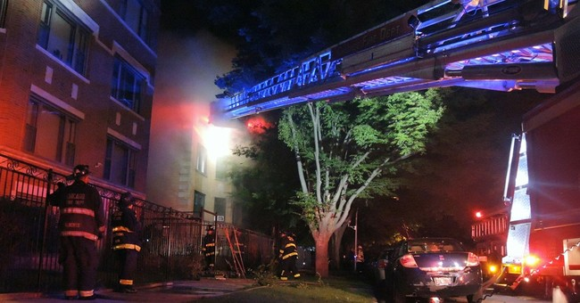 The Latest: 200 firefighters fought deadly Chicago blaze