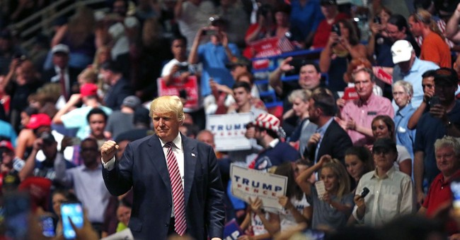 In latest hedge, Trump says immigration laws can be softened