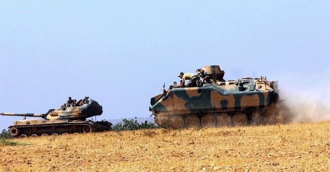 The Latest: Report: Turkey evacuates town near Syria border