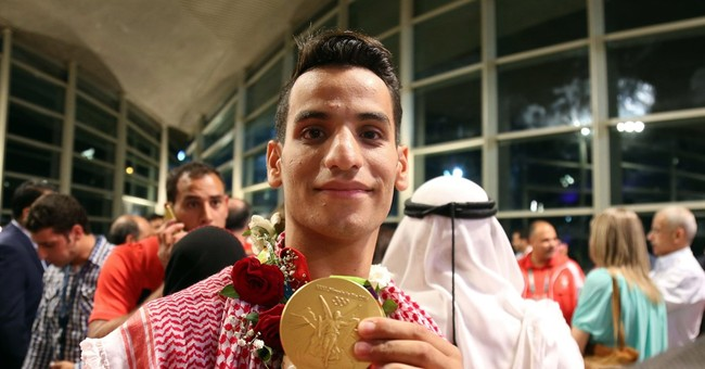 Jordan's first Olympic medalist comes home to royal welcome