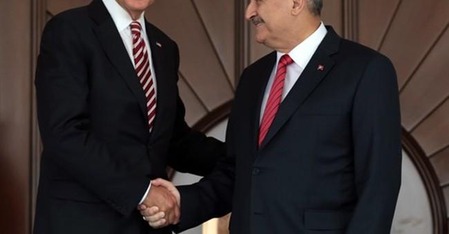 The Latest: Erdogan says Syrian rebels take back border town