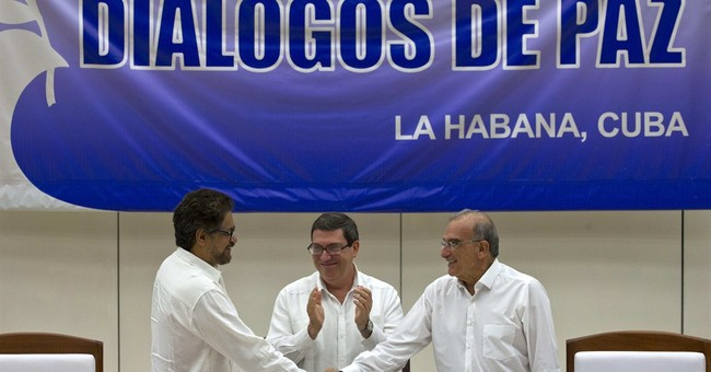 The Latest: UN schedules meeting to discuss role in Colombia