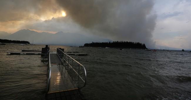 Yellowstone tourists see smoke, detour but still the sights