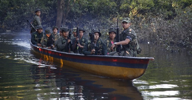 AP PHOTOS: Colombia rebels relax, play soccer as peace nears