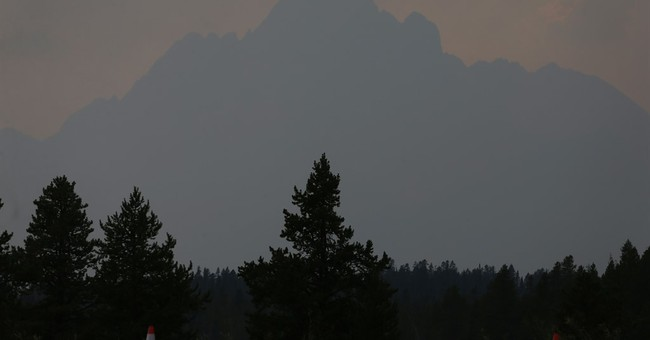 Crews battling 35 large, uncontained wildfires in the West