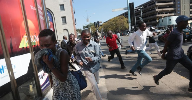 Zimbabwe police fire tear gas, gunshots to quell protests