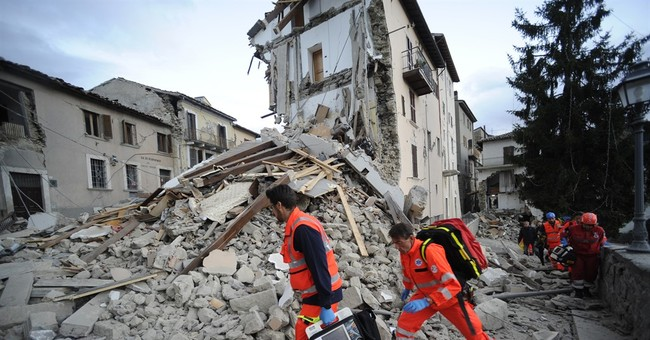 The Latest: World Trade Center honors Italy quake victims