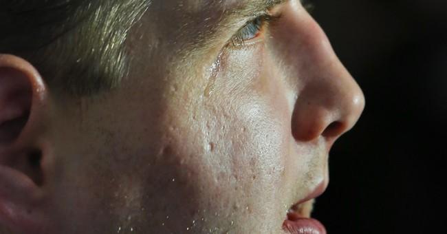 Burned firefighter feels normal again after face transplant