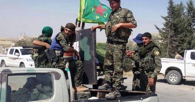 The Latest: Turkish artillery strikes Syrian Kurdish militia