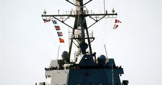 US warship fires warning shots at Iranian boats