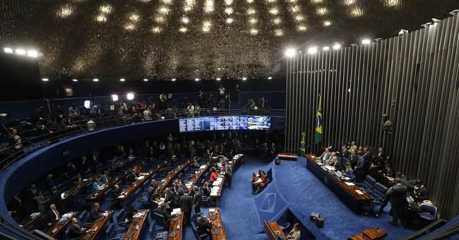 Brazilian senators blast each other as Rousseff trial starts