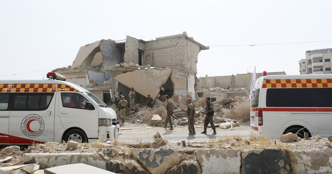 Rebels, civilians leave town after four-year siege