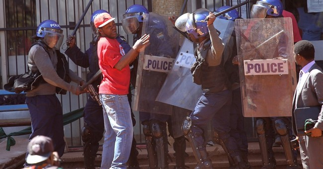 Zimbabwe police crush anti-government protest in capital