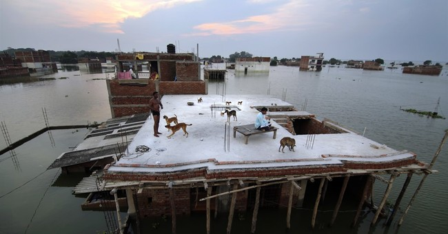 Flood waters stabilize in India, but thousands evacuated