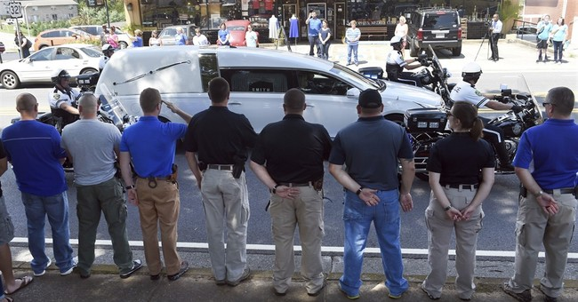 Tennessee man charged in shooting death of police officer