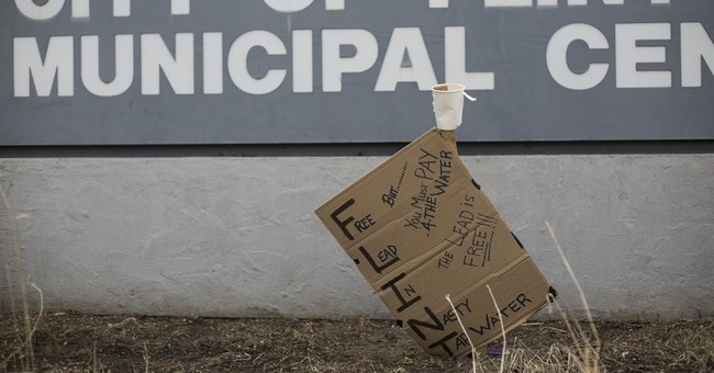 Problems in Detroit, Flint show rift over emergency managers