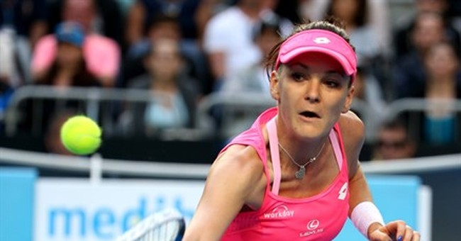 Teary finish: Radwanska holds off cramping Friedsam