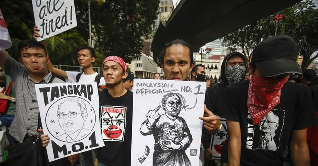 Malaysian students rally to demand prime minister's arrest