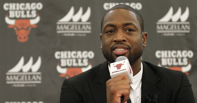 Latest: Wade's cousin hit by stray shot in possible robbery