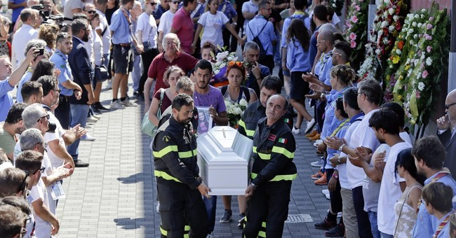 Grief erupts in Italy as nation honors, buries quake dead