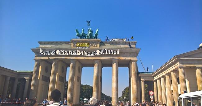 Far-right anti-Islam activists protest atop Berlin monument