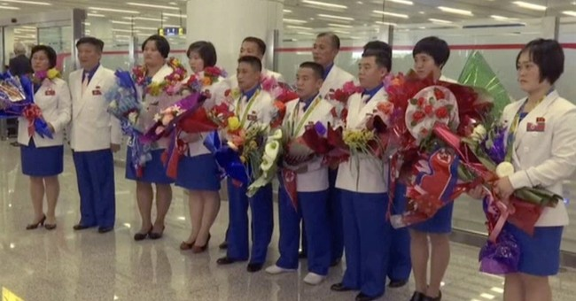 North Korean Olympic athletes return home to low-key welcome