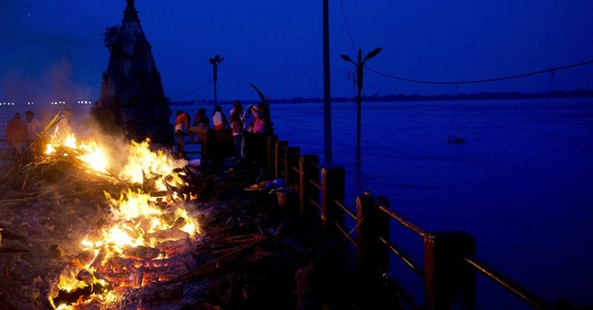 AP PHOTOS: Ganges overflows its banks in Indian holy town