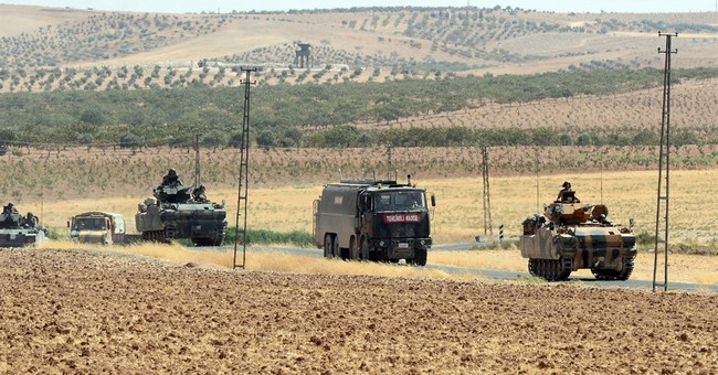 The Latest: US asks Turkey to focus on fight against IS